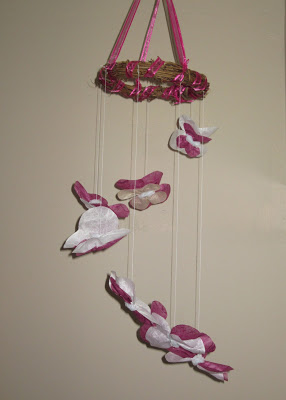 I love DIY projects! Check out this beautiful DIY butterfly mobile craft!
