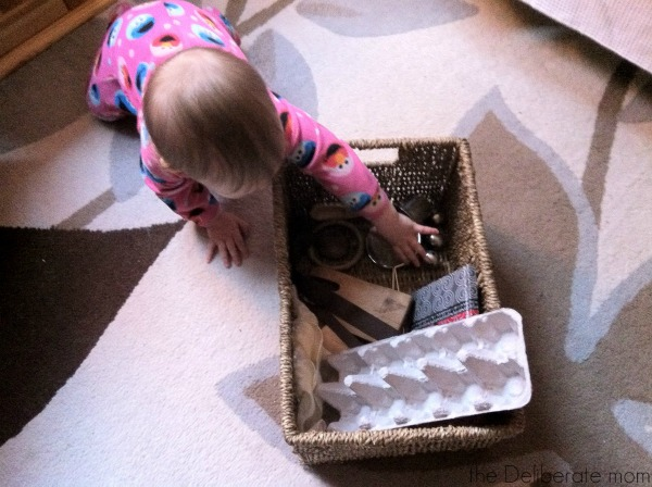 Infant playing with a treasure basket: Heuristic play.