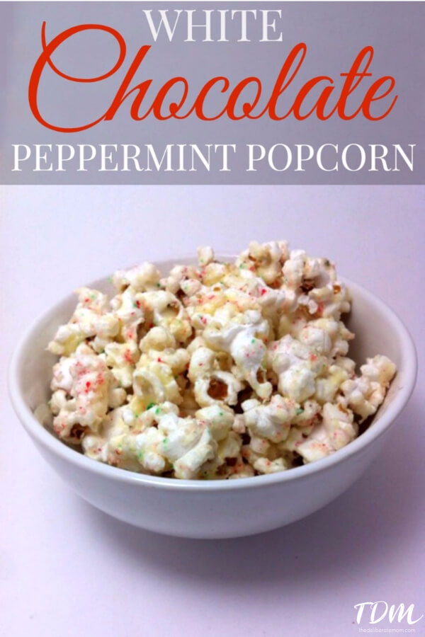 White Chocolate Peppermint Popcorn - this is ADDICTIVE! Popcorn is coated with white chocolate and sprinkled with crushed candy canes. A fabulous Christmas treat!