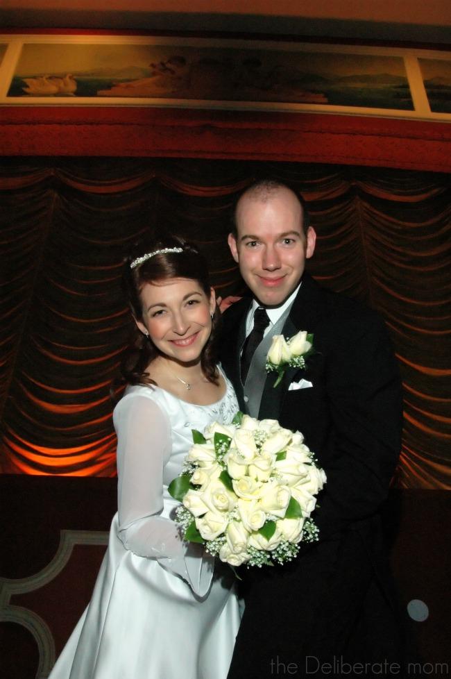 Formal wedding photos in a historic movie theatre.