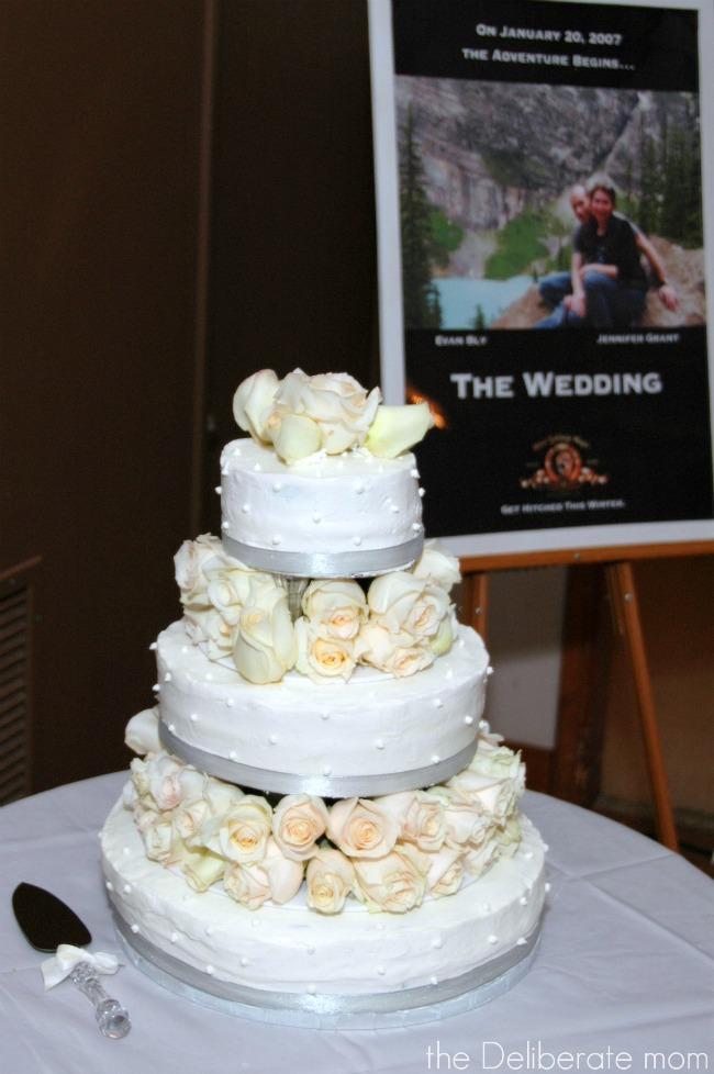 White rose topped wedding cake.
