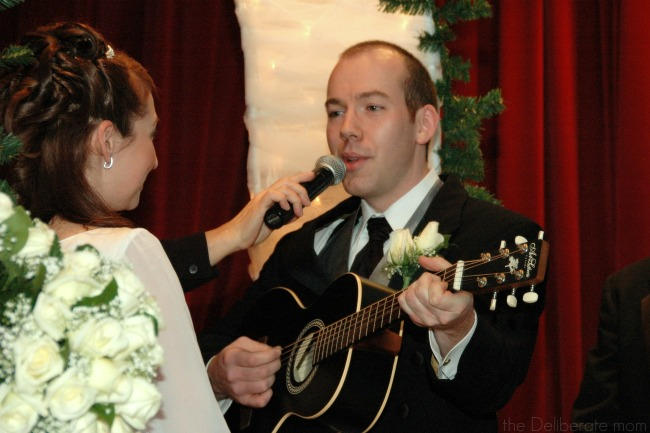 My husband singing a song for his wedding vows.