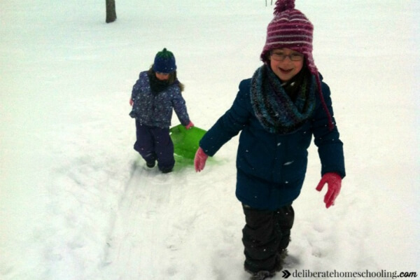Sledding is a fabulous physical education activity to do with your homeschooler in the winter.
