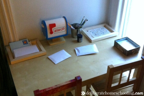 """It's important not to rush children into reading. However, there are some fun ways to prepare and teach your preschooler to read... such as setting up a writing centre and a """"post office box""""."""